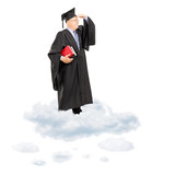 Mature college professor in graduation gown standing on cloud