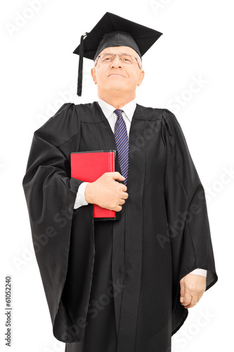 Proud male college professor holding books and standing