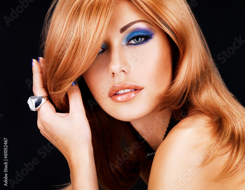 portrait of a  woman with long red hairs and  fashion makeup