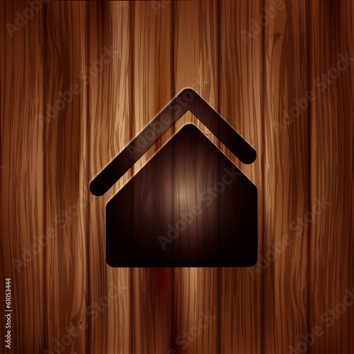 Home icon. House symbol. Wooden background
