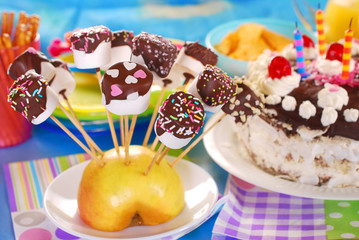 marshmallow pops with chocolate and colorful sprinkles