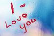 Inscription lipstick on glass on bright background