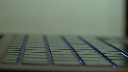 Turning laptop with illuminated keyboard