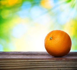 Orange on wooden table