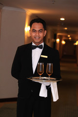 waiter or butler at five star hotel corridor