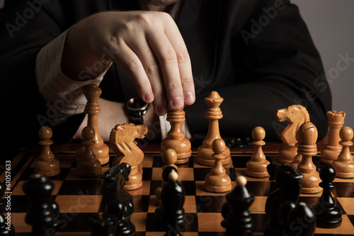 man makes a move chess figure