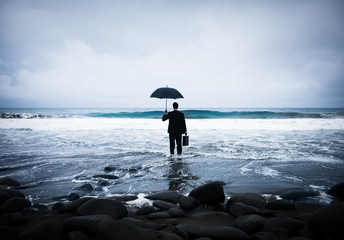 Businessman Facing a Storm
