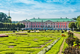 Park with statues and Palace of earl Sheremetyev in mansion Kusk