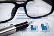 closeup glasses on financial report