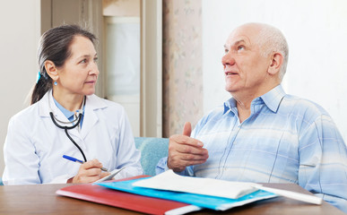 doctor examining the senior patient