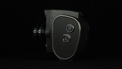8 mm camera is rotated on a black background loop