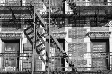 Old Building fire ladder in black and white