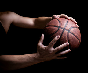 Basketball ball in the hands