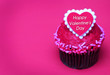 Chocolate cupcake with Valentines heart on the top, over pink