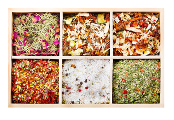 various spices on wooden box