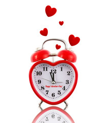 Heart-shaped alarm clock ringing with hearts isolated on white