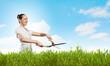 Woman cutting lawn