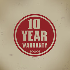 10 year warranty sign on old background