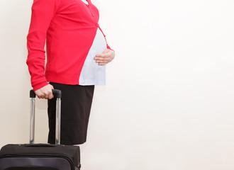 Pregnant businesswoman travel
