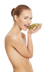 Beautiful caucasian topless woman with fresh green cress.