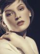 Vogue. Female portrait against dramatic dark backgrounds
