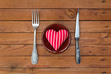St Valentine's day greeting card with plate, knife, fork and hea