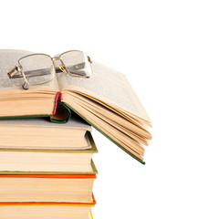 Stack of books and glasses. Isolated on white.