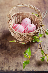 Basket with pink easter eggs