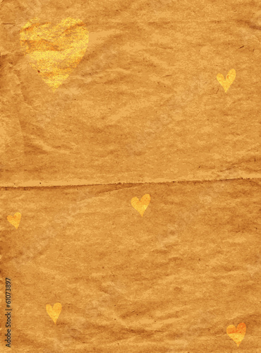 Old spotty grunge paper with gold hearts