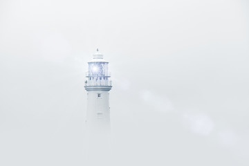 lighthouse in mist