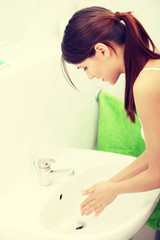 Beautiful caucasian woman washing hands