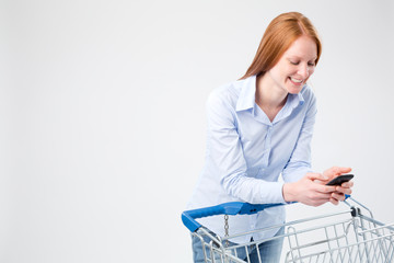 Smiling Woman with a Shopping Cart
