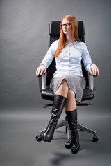 Confident Business Woman in a Chair