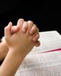 Hands of a Child Clasped in Prayer