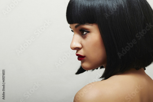 Beautiful Brunette Woman.Healthy Black Hair.Retro Haircut