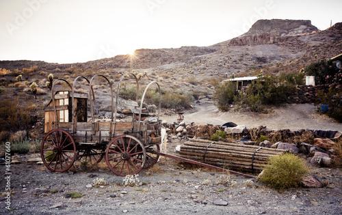 Horse drawn wagon in the Mojave desert. - 61077660