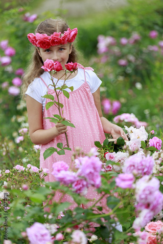 Rose garden - cute girl playing in the rose garden