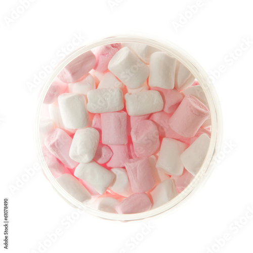Open Glass jar of pink and white Marshmallow  from above