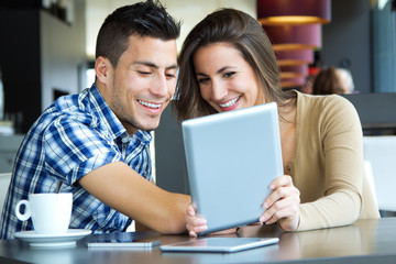 young couple browsing internet with digital tablet