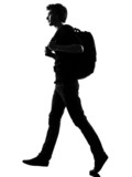 young man silhouette backpacker walking