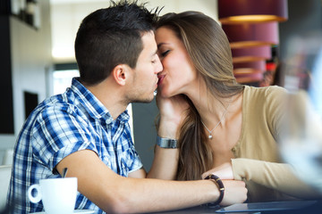 young couple in love at a coffee shop