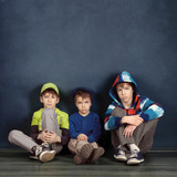 Portrait of three brothers on blue background
