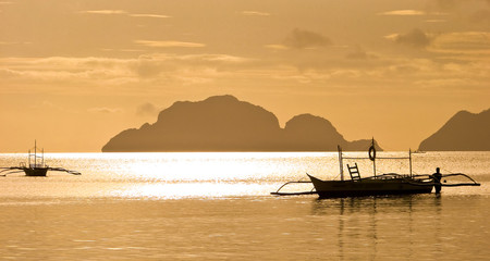 Sunset and fishing boats, The Philippines