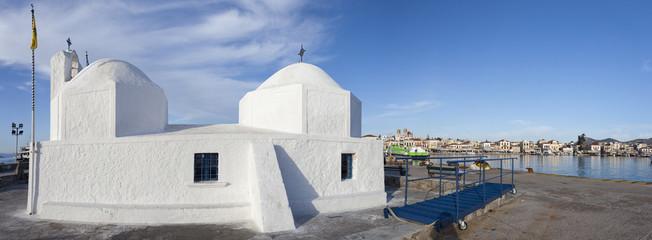 White chapel in the harbor of Aegina.Greece.