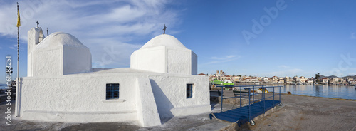 White chapel in the harbor of Aegina.Greece.