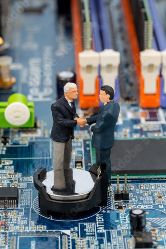 two managers on computer board