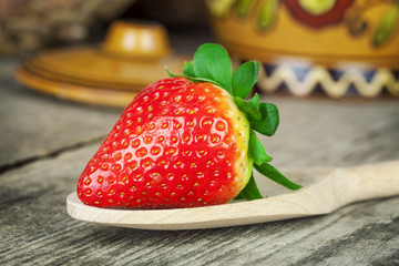 Fresh juicy strawberries on a wooden table