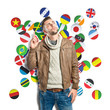 Young man thinking over background with flags