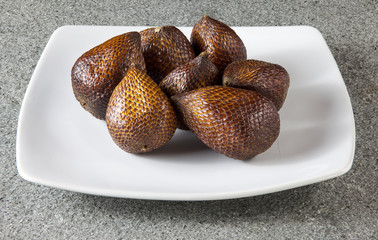 Salak Fruit on white plate