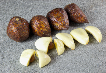 Salak Fruit peeled on grey stone